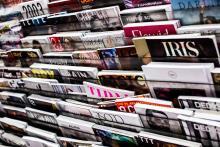 Magazines in kiosk. Foto door Charisse Kenion via Unsplash